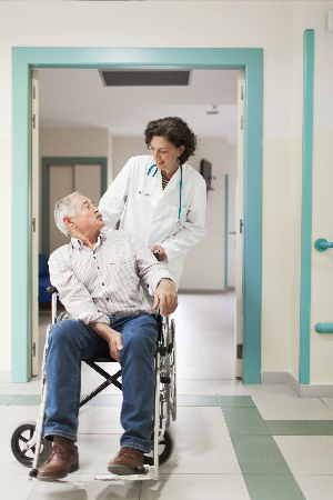 Family Physician caring for an male adult patient